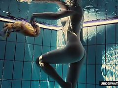 Hot big titted teen Lera swimming in the pool