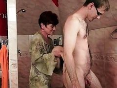 Redheaded granny fucking a young man