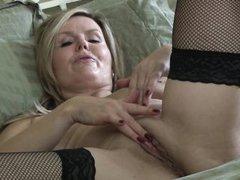 hot mamma opens her long legs